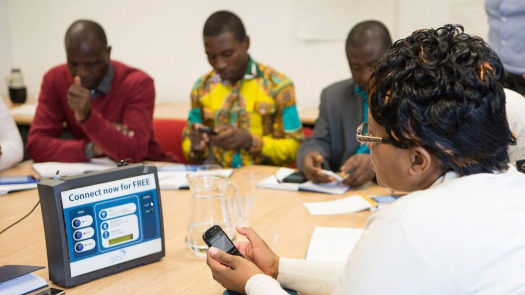 African meeting with BluPoint Hub on table